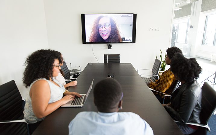 People meeting virtually and in person