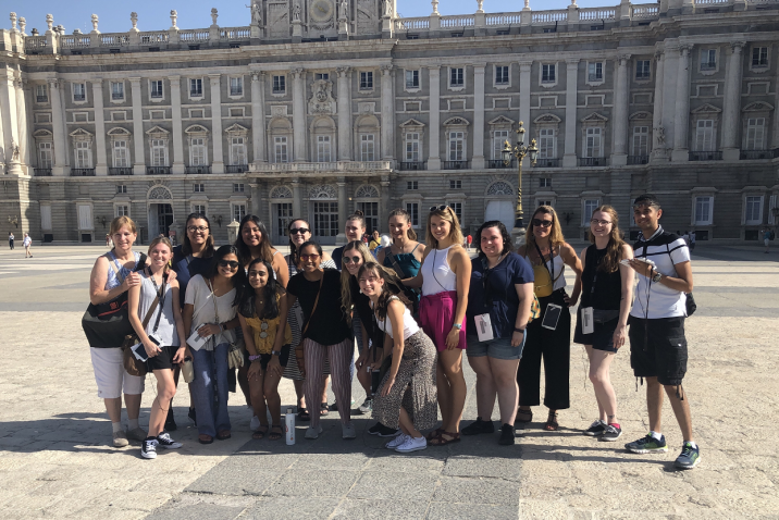 group of people in front of a palace