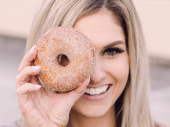 woman looking through donut hole