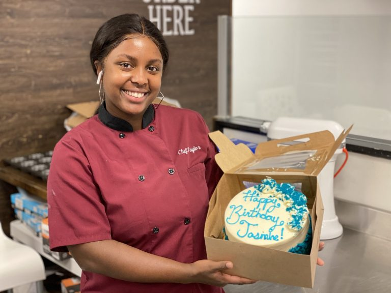woman smiling with cake