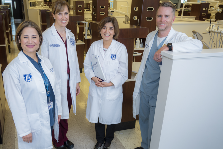 3 women and 1 man in whitecoats
