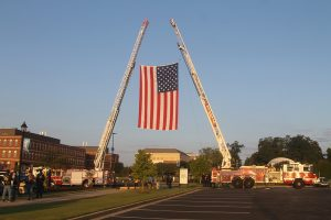 Firetrucks displaying American flag