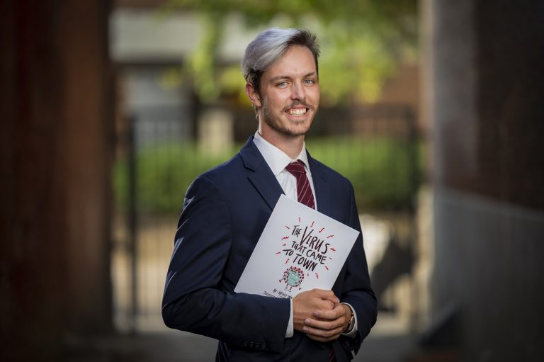man standing with book