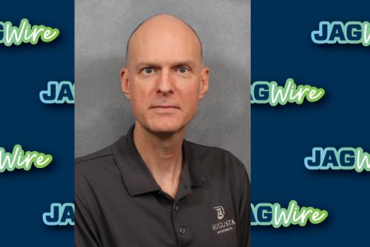 headshot of Dr. Morris over blue background