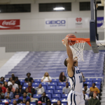 male player dunking a basketball