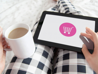 woman using tablet to do online shopping