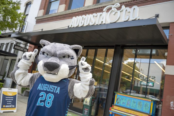 Mascot in front of store