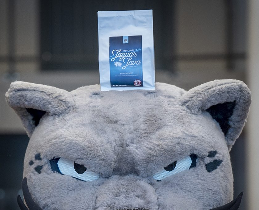Mascot with coffee on head