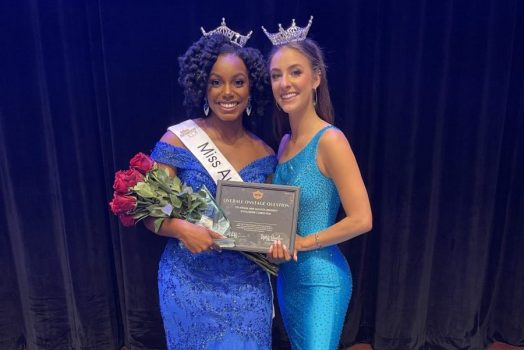 two women wearing blue dresses and crowns
