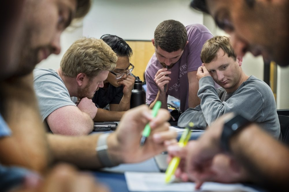 Augusta University physical therapy students separate into groups to read patient case scenarios and decide on a treatment during class at the Health Sciences Building on the AU Health Sciences campus.  6/22/21 3:19:35 PM  Photo by Michael Holahan/Augusta University  Job #402070